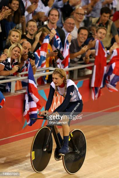 Laura Trott of Great Britain celebrates with her family after winning the Gold medal in the Women's Omnium Track Cycling 500m Time Trial on Day 11 of...