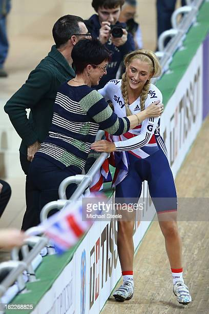 Laura Trott of Great Britain celebrates with her mother Glenda and father Adrian after winning gold in the women's team pursuit during day two of the...