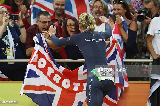 Laura Trott of Great Britain celebrates with the crowd after winning gold in the women's Omnium Points race on Day 11 of the Rio 2016 Olympic Games...