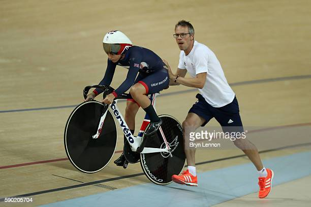 Laura Trott of Great Britain gets a start from coach Paul Manning during the Women's Omnium Flying Lap 56 race on Day 11 of the Rio 2016 Olympic...