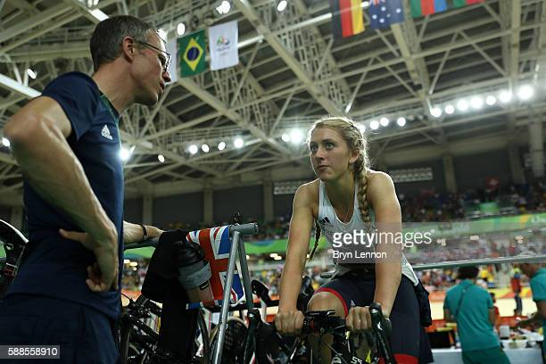 Laura Trott of Great Britain speaks to coach Paul Manning on Day 6 of the 2016 Rio Olympics at Rio Olympic Velodrome on August 11 2016 in Rio de...