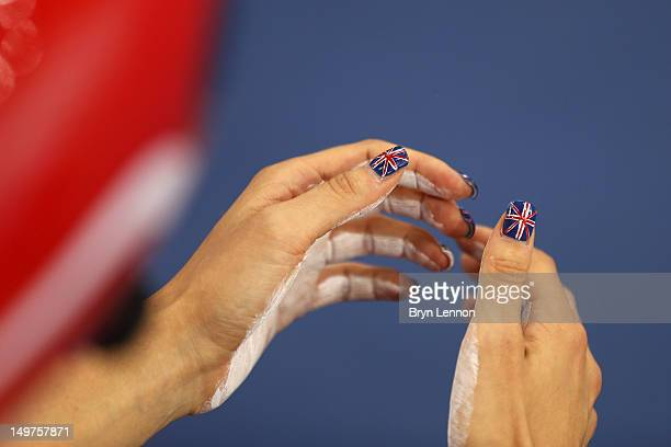 Laura Trott of Great Britain's thumbnails decorated with Union Jacks as she prepares to compete before the Women's Team Pursuit Track Cycling...