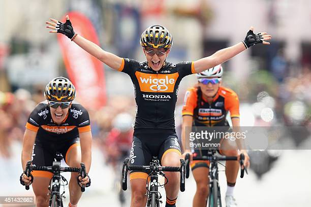 Laura Trott of Wiggle Honda celebrates crossing the finish line to win the Elite Women British National road race championships on June 29 2014 in...