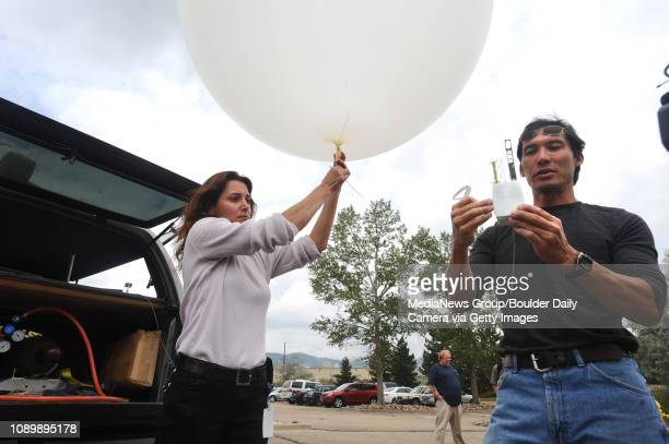 Laura Tudor left and Timothy Lim technicians at the National Center for Atmospheric Research prepare to release a weather balloon and its radiosonde...