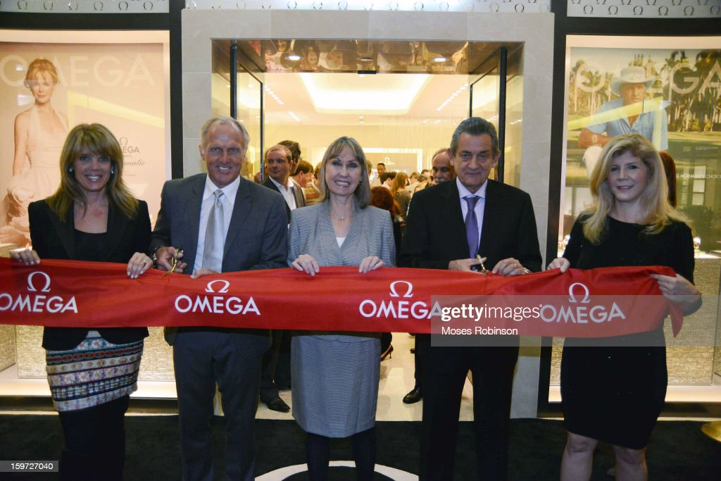 Laura Turner Seydel (L), Greg Norman (2nd R), Stephen Uraquhart (2nd R) and Nina Cheney (R) attend the OMEGA boutique opening at Phipps Plaza on January 17, 2013 in Atlanta, Georgia.