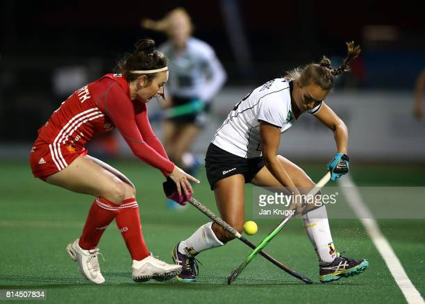 Laura Unsworth of England battles with Lisa Altenburg of Germany during day 4 of the FIH Hockey World League Women's Semi Finals Pool A match between...