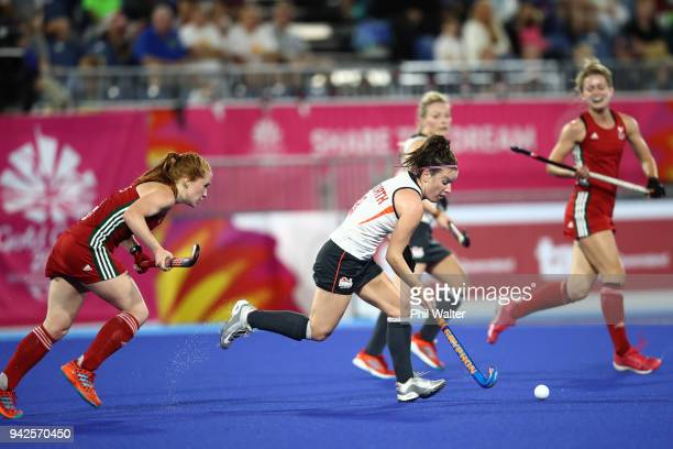 Laura Unsworth of England runs the ball during their Womens Hockey match between England and Wales on day two of the Gold Coast 2018 Commonwealth...