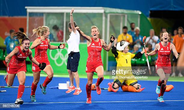 R Laura Unsworth Sophie Bray Alex Danson and Helen RichardsonWalsh of Great Britain celebrate victory after the Women's hockey Gold medal match...