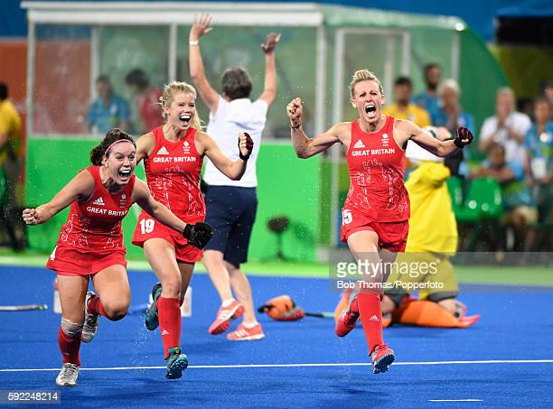 R Laura Unsworth Sophie Bray and Alex Danson of Great Britain celebrate victory after the Women's hockey Gold medal match between The Netherlands and...