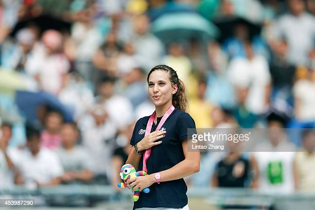 Laura Valette of France celebrates during the medal ceremony after the Women's 100m Hurdles Final of Nanjing 2014 Summer Youth Olympic Games at the...