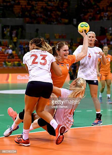 Laura van der Heijden of Netherlands takes a shot under pressure of Camilla Herrem and Stine Bredal Oftedal of Norway during the Women's Handball...