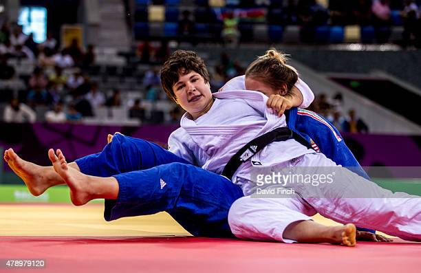 Laura Vargas Koch of Germany holds Szabina Gersack of Hungary for an ippon helping Germany beat Hungary by 3 - 2 on their way to the silver medal at...