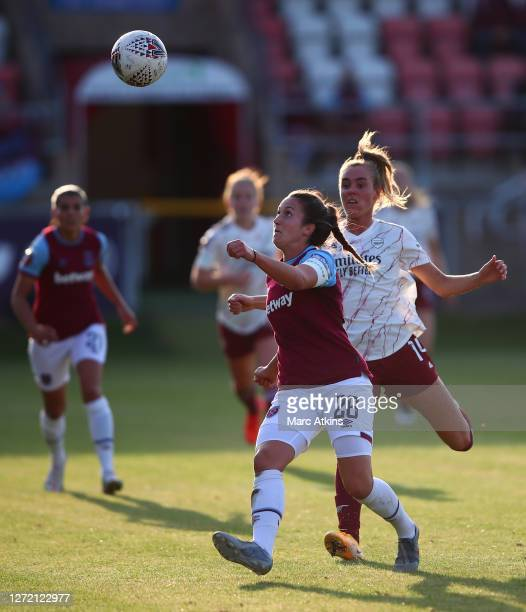 Laura Vetterlein of West Ham United is challenged by Jill Roord of Arsenal during the FA Women's Super League match between West Ham United and...