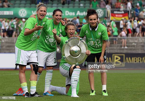 Laura Vetterlein Selina Wagner Josephine Henning and Lina Magull of VfL Wolfsburg celebrate with the trophy after the Women's Bundesliga match...