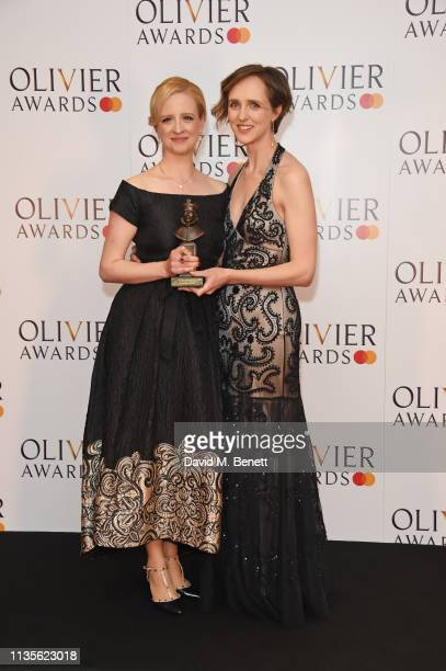 Laura Wade and Tamara Harvey accepting the Best New Comedy award for 'Home I'm Darling' pose in the press room at The Olivier Awards 2019 with...