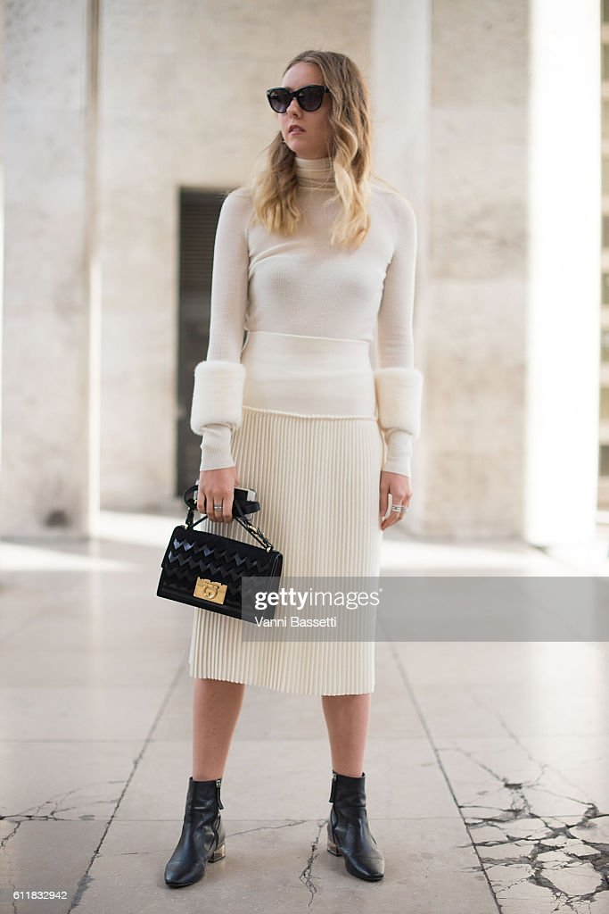 8db18e72497 Laura Werner poses wearing a Salvatore Ferragamo dress and bag after ...