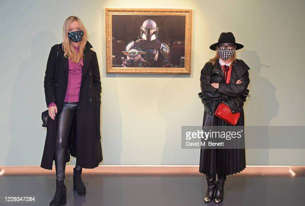 """Laura Whitmore and Erica Bergsmeds attend a private view of """"The Mandalorian And The Child"""", a special portrait being unveiled in collaboration with..."""