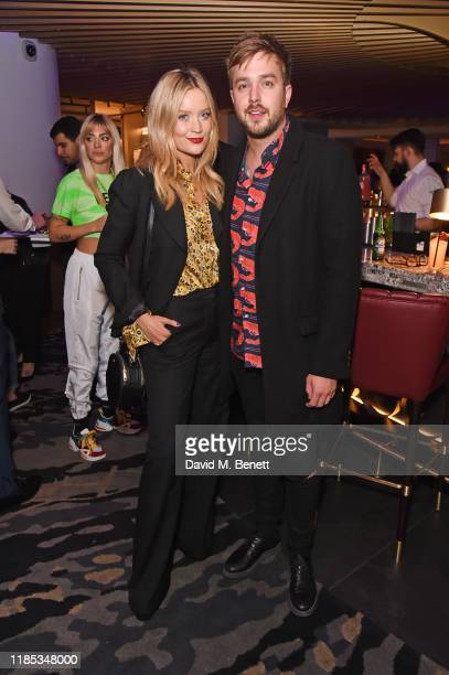 Laura Whitmore and Iain Stirling attend the 20th anniversary celebration of tailor and fashion designer Gresham Blake at the Hard Rock Hotel London...