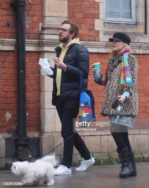 Laura Whitmore and Iain Stirling seen walking their dog and getting a coffee in Westbourne Grove, Notting Hill sighting on February 17, 2021 in...