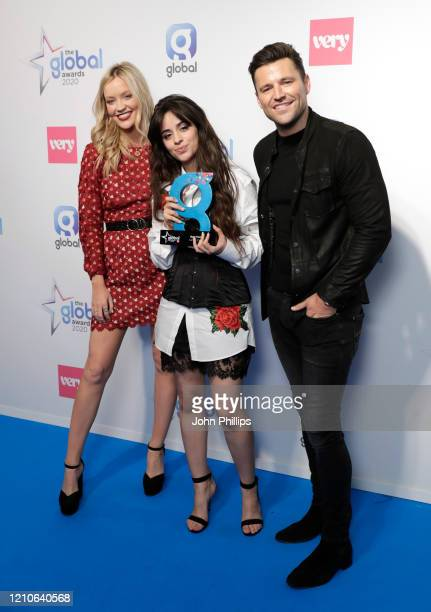 Laura Whitmore and Mark Wright with Camila Cabello winner of the Best Female Award at The Global Awards 2020 at Eventim Apollo Hammersmith on March...