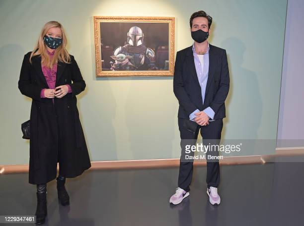 """Laura Whitmore and Nick Grimshaw attend a private view of """"The Mandalorian And The Child"""", a special portrait being unveiled in collaboration with..."""