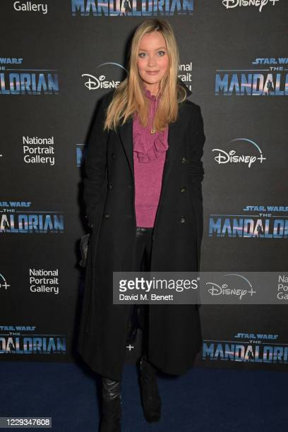 """Laura Whitmore attends a private view of """"The Mandalorian And The Child"""", a special portrait being unveiled in collaboration with the National..."""
