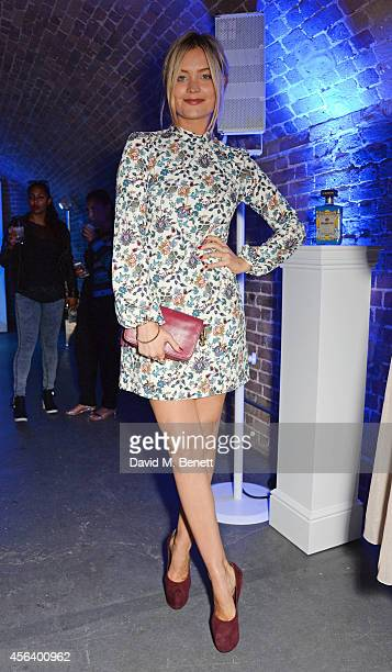 Laura Whitmore attends the Disaronno Wears Versace limited edition bottle launch at One Mayfair on September 30 2014 in London England