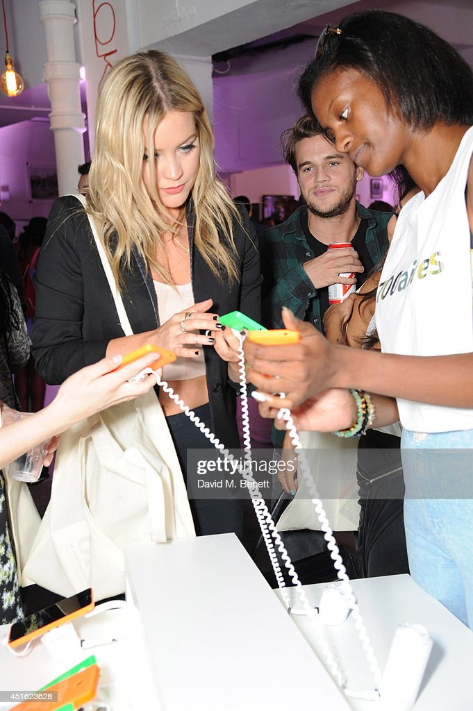 Laura Whitmore (left) attends the Nokia Lumia 630 #100aires Pop-up store, at The Old Truman Brewery on July 2, 2014 in London, England.