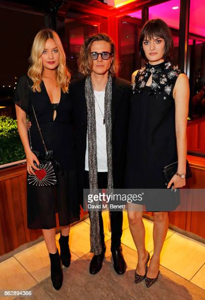 Laura Whitmore Dougie Poynter and Sam Rollinson attend the launch of The Trafalgar St James in the hotel's spectacular new bar The Rooftop on October...