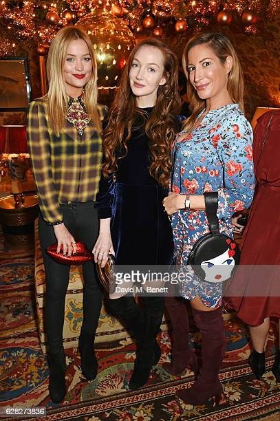 Laura Whitmore Olivia Grant and Laura Pradelska attend as Lulu Guinness Jasmine Guinness celebrate Christmas with friends at Upstairs 5 Hertford...
