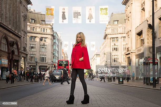 Laura Whitmore poses at the opening of Oxford Street's Fashion Showcase on September 9 2014 in London England The Oxford Street Fashion Showcase...