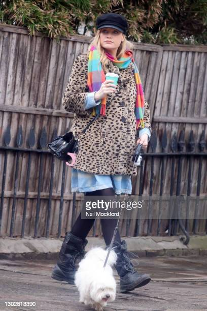 Laura Whitmore seen walking the dog and getting a coffee in Westbourne Grove, Notting Hill sighting on February 17, 2021 in London, England.