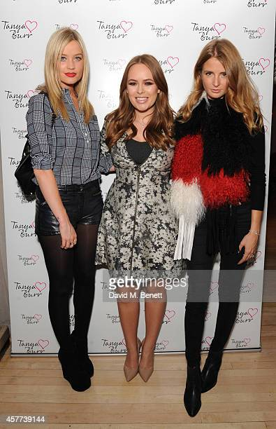 Laura Whitmore Tanya Burr and Millie Mackintosh attend the new product launch for Tanya Burr Cosmetics at Sanderson Hotel on October 23 2014 in...