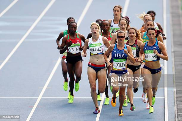 Laura Whittle of Great Britain, Kim Conley of the United States, and Shelby Houlihan of the United States lead the pack during the Women's 5000m...