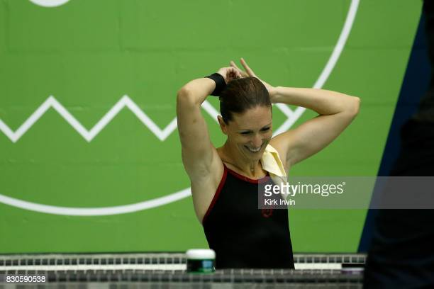 Laura Wilkinson of the Woodlands Diving Academy rests in the hot tub in between dives during the Senior Women's Platform Final during the 2017 USA...