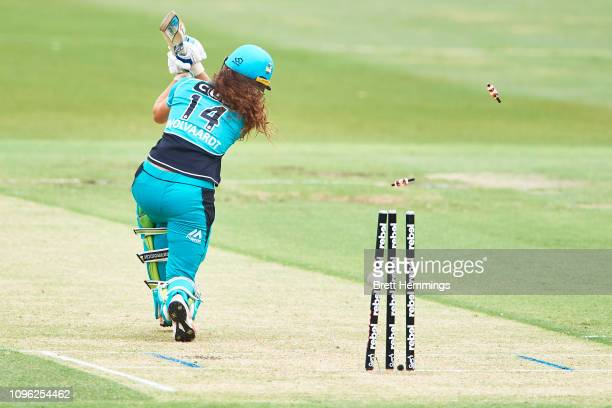 Laura Wolvaardt of Brisbane is bowled out by Nicola Carey of the Thunder during the Women's Big Bash League match between the Sydney Thunder and the...