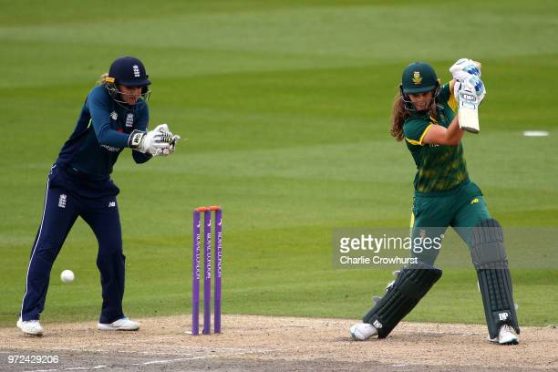 Laura Wolvaardt of South Africa hits out while Sarah Taylor of England watches on during the ICC Women's Championship 2nd ODI match between England...