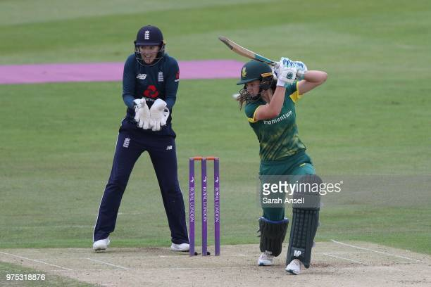 Laura Wolvaardt of South Africa Women hits out as Sarah Taylor of England Women looks on during the 3rd ODI of the ICC Women's Championship between...