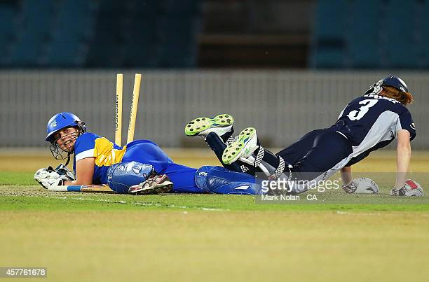 Laura Wright of the ACT attempts to run out Kelly Applebee of the Spirit during the women's T20 match between the ACT and Victoria at Manuka Oval on...