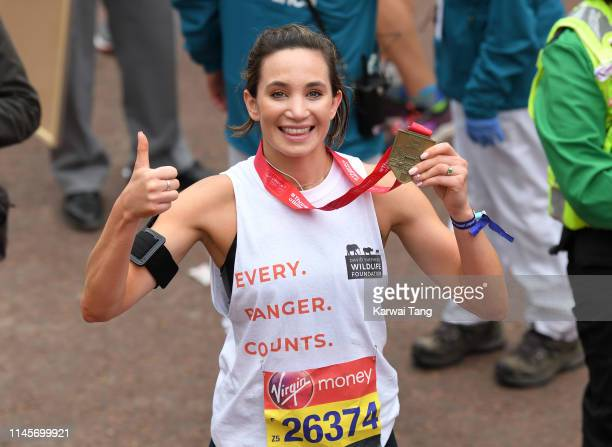 Laura Wright poses with her medal after completing the Virgin London Marathon 2019 on April 28, 2019 in London, United Kingdom.