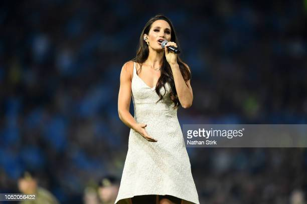 Laura Wright sings prior to the BetFred Super League Grand Final between Warrington Wolves and Wigan Warriors at Old Trafford on October 13 2018 in...