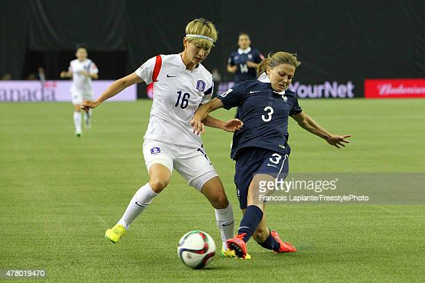 Laure Boulleau of France battle for the ball against Yumi Kang of Korea during the FIFA Women's World Cup Canada 2015 round of 16 match between...