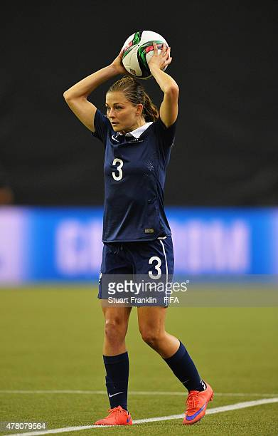 Laure Boulleau of France is challenged by of Korea during the FIFA Womens's World Cup round of 16 match between France and Korea at Olympic Stadium...