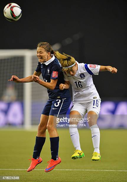 Laure Boulleau of France is challenged by Yumi Kang of Korea during the FIFA Womens's World Cup round of 16 match between France and Korea at Olympic...