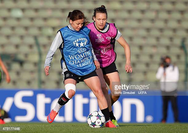 Laure Boulleau of Paris St Germain is challenged by a team mate during the training session the day before the UEFA Women's Champions League Final...