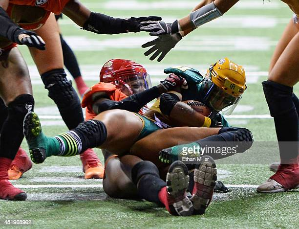 Laure GelisDiaz of the Green Bay Chill is tackled by LaRonda Kelly of the Las Vegas Sin during their game at the Thomas Mack Center on May 15 2014 in...