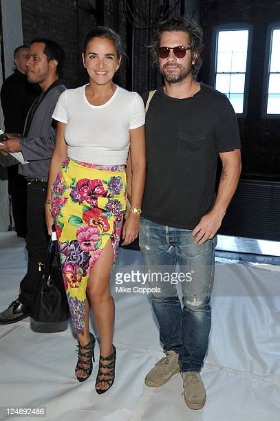 Laure Heriard Dubreuil and artist Aaron Young attend the Theyskens' Theory Spring 2012 fashion show during MercedesBenz Fashion Week at Center 548 on...