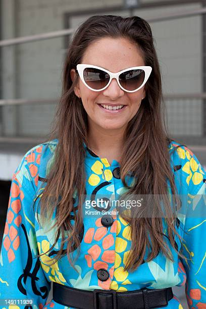 Laure Heriard Dubreuil store owner wearing a vintage YSL jumpsuit and Tom Ford sunglasses at Paris Fashion Week Spring/Summer 2013 menswear shows on...