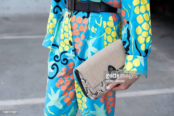 Laure Heriard Dubreuil store owner wearing a vintage YSL jumpsuit and a Balenciaga bag at Paris Fashion Week Spring/Summer 2013 menswear shows on...