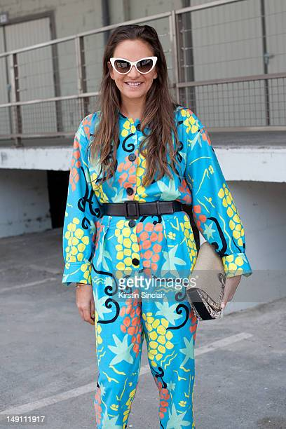 Laure Heriard Dubreuil store owner wearing a vintage YSL jumpsuit Balenciaga bag and Tom Ford sunglasses at Paris Fashion Week Spring/Summer 2013...